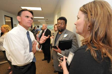 This photo is courtesy of The Macomb Daily. Unfortunately, I don't remember who took it, possibly David Dalton. But that's me talking with Macomb County Executive Mark Hackel at the Macomb Regional Community Media Lab launch party Tuesday.